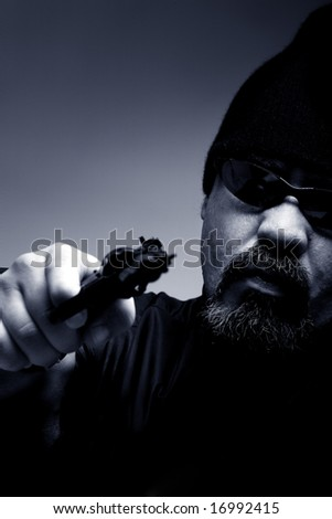 Portrait of a professional assassin - stock photo