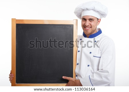 Portrait of a professional chef holding a blackboard. Isolated on white