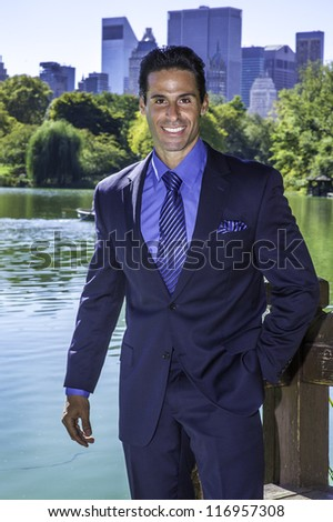 Portrait of  a professional executive. The background is a beautiful business district environment. - stock photo