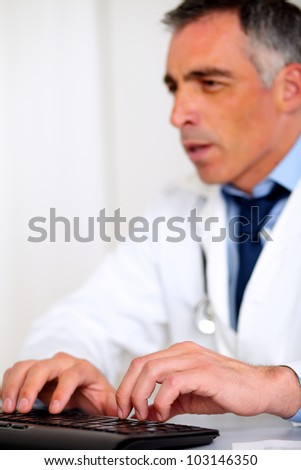 Portrait of a professional medical specialist working at the hospital - stock photo