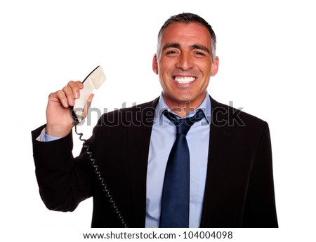 Portrait of a professional person smiling with a phone on black suit against white background - stock photo