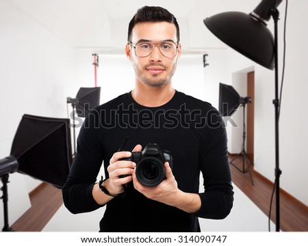 Portrait of a professional photographer in his studio