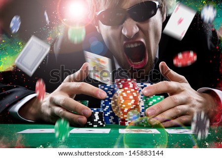 Portrait of a professional poker player - stock photo