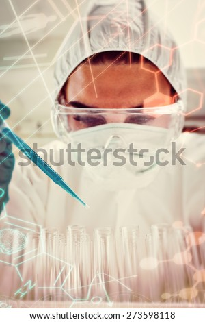 Portrait of a protected female science student dropping blue liquid in a test tubes against science and medical graphic - stock photo