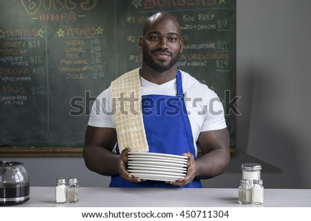 Portrait of a proud restaurant worker - stock photo
