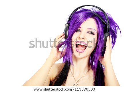 Portrait of a punk girl in headphones. Isolated over white background.