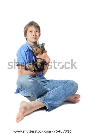 portrait of a purebred yorkshire terrier and young teen in front of white background