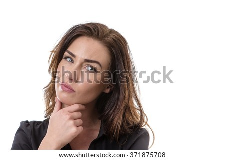 Portrait of a puzzled woman looking at the camera - stock photo