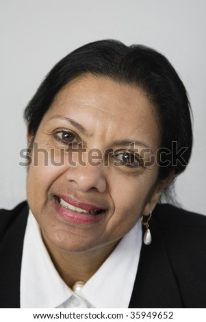Portrait of a questioning businesswoman against white background.