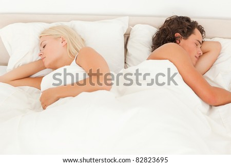 Portrait of a quiet couple sleeping in their bedroom