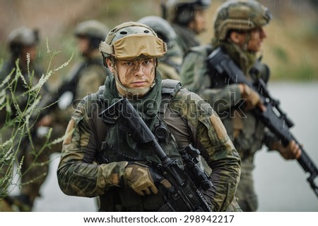 Portrait of a ranger in the battlefield with a rifle