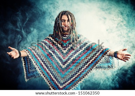 Portrait of a rastafarian young man. - stock photo
