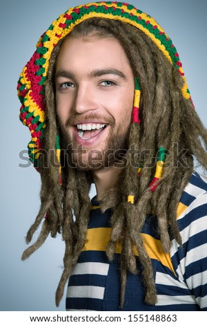 Rasta hair stock images royalty free images vectors shutterstock portrait of a rastafarian young man publicscrutiny Image collections