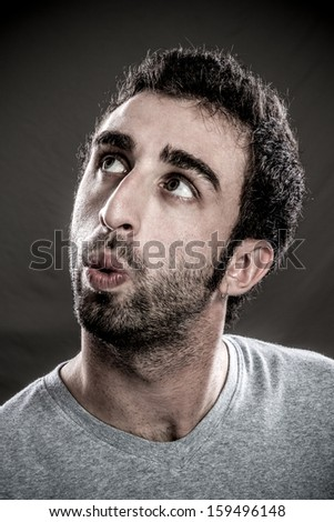 Portrait of a real man whistling to anyone - stock photo