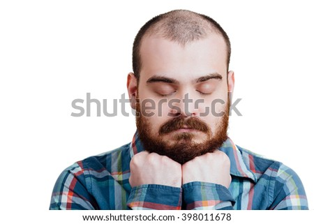 Portrait of a red-bearded, balding male brutal. White isolated background. A man in a blue plaid shirt. Sad, upset, disappointed and frustrated, propped his head with hands. closed eyes. - stock photo