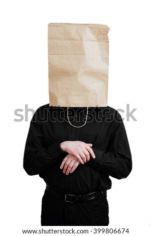 Portrait of a red-bearded, balding male brutal. White isolated background. Black shirt and pants. Paper bag over head. Waiting for decision. - stock photo