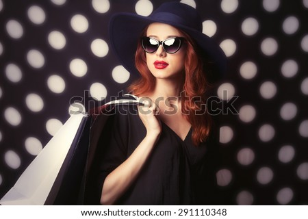young attractive woman in mask over dark background stock