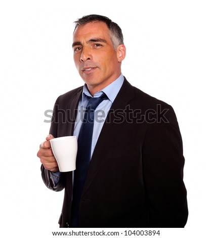 Portrait of a reflective charming man with a white mug on black suit on isolated background - stock photo