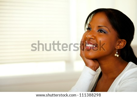 Portrait of a relaxed afro-American young woman smiling. With copyspace - stock photo
