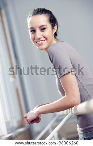 Portrait of a relaxed attractive young woman after exercise - stock photo