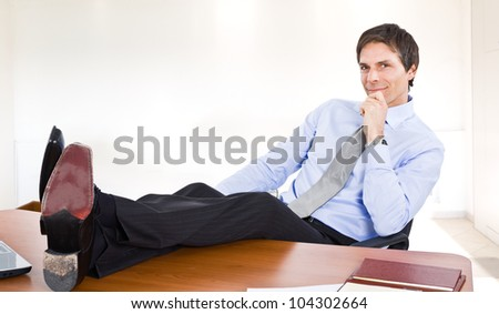 Portrait of a relaxed businessman - stock photo