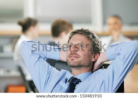 Portrait of a relaxed Businessman, business meeting on background - stock photo