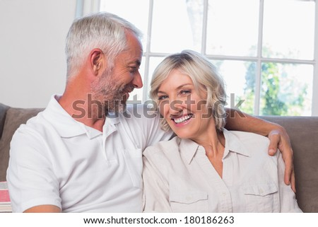 Portrait of a relaxed happy mature couple sitting on couch at home