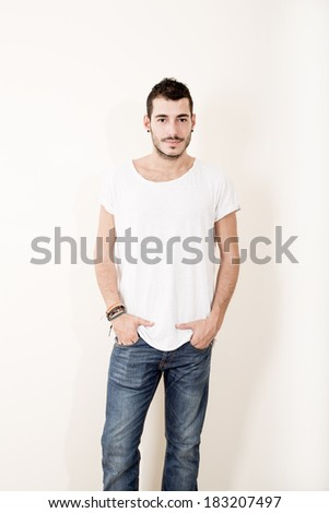 Portrait of a relaxed latin man in casual clothes.