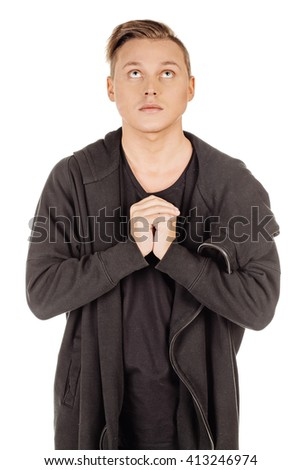 Portrait of a religious expressive man praying in studio on white isolated background - stock photo