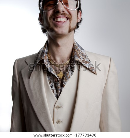 Portrait of a retro man in a 1970s leisure suit and sunglasses smiling to the camera  - stock photo