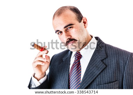 portrait of a rich businessman smoking a big cigar isolated over a white background