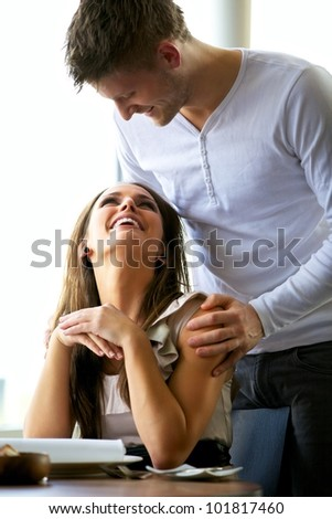Portrait of a romantic couple looking at each other at a restaurant - stock photo