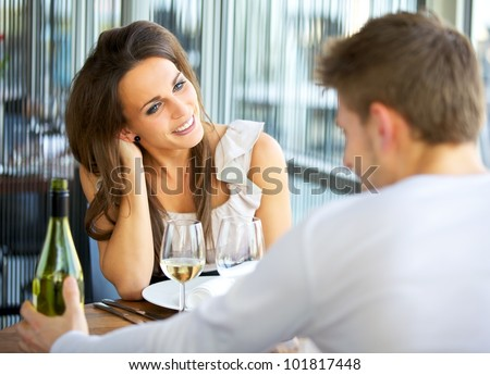 Portrait of a romantic dating couple at a restaurant - stock photo