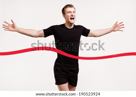 portrait of a runner at the finish line isolated on white background - stock photo