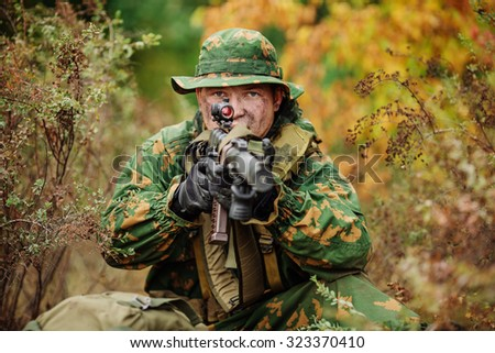 Portrait of a russian soldier in the battlefield with a rifle