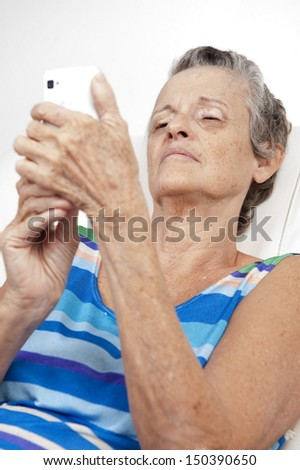 Portrait of a 60s senior on the phone - stock photo