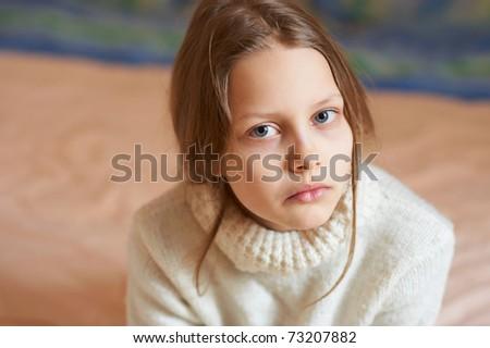 Portrait of a sad blond little girl, shallow DOF - stock photo
