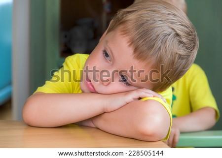 portrait of a sad child - stock photo