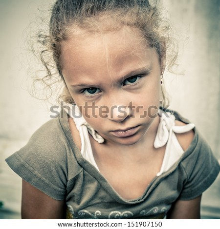 portrait of a sad girl on a background white wall - stock photo