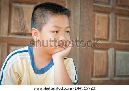 portrait of a sad little boy - stock photo