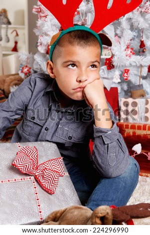 Portrait of a sad little boy at Christmas