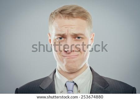 Portrait of a sad man - stock photo