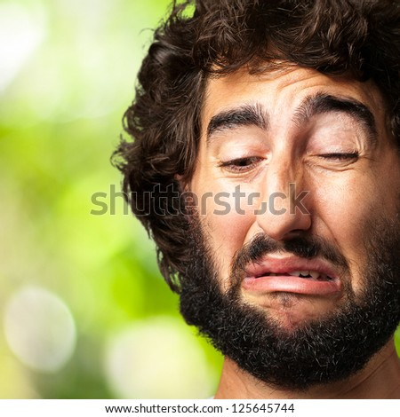 Portrait Of A Sad Man against a nature background - stock photo
