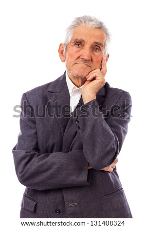 Portrait of a sad senior deep in thoughts on white background - stock photo