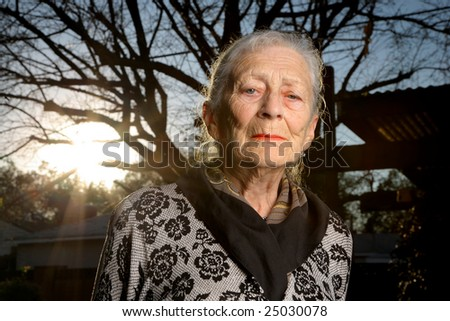 Portrait of a sad senior woman outdoors - stock photo