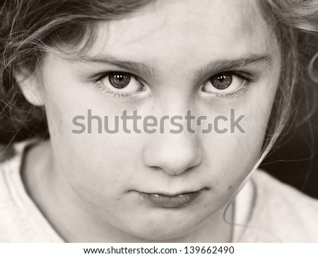 Portrait of a sad, serious girl. - stock photo