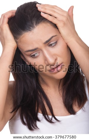 Portrait of a sad woman on isolated white - stock photo