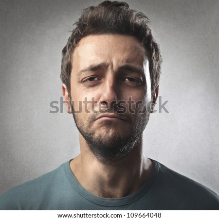 Portrait of a sad young man - stock photo