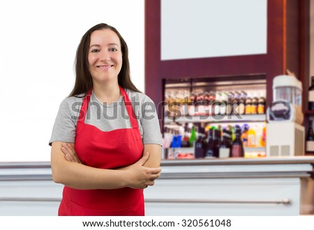 portrait of a saleswoman with crossed arms at the cafe - stock photo