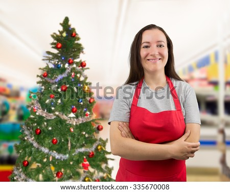 portrait of a saleswoman with crossed arms on Christmas - stock photo